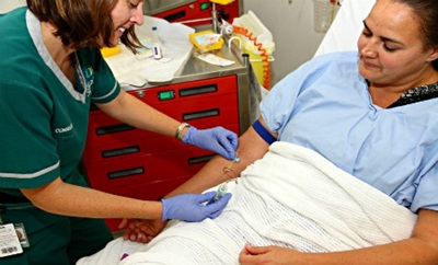 Nurse taking a blood test from patient's forearm