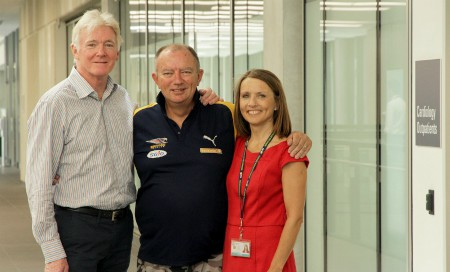 Dr Robert Larbalestier, Rodney Western and Clare Fazackerley standing together in the corridor of Fiona Stanley Hospital
