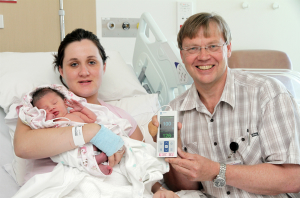 Lisa Bailey and her daughter Isla-Marie Ranui as Dr Jean Du Plessis demonstrate the use of the pulse oximeter to monitor the baby's oxygen levels