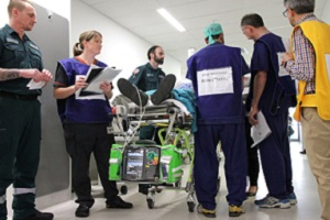 A team of health professionals assessing a 'patient' during a clinical simulation