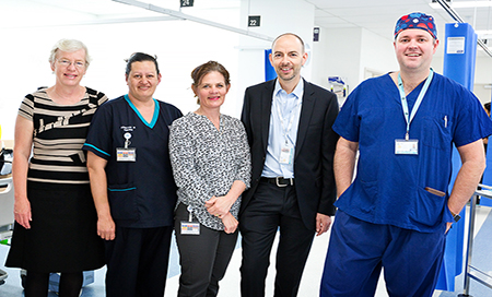Group of 5 staff on hospital ward