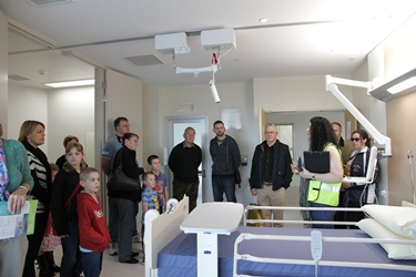 A tour group inside a patient room at FSH