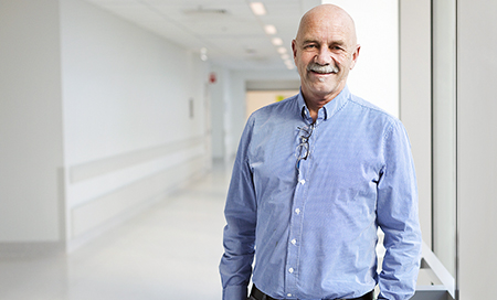 Michael Jacobson stands in a hospital corridor